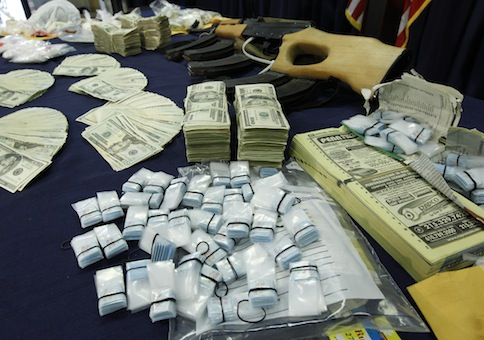 Confiscated heroin and money seized by Philadelphia Police / AP