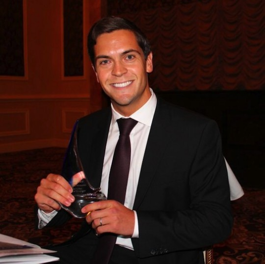 Facebook spouse Sean Eldridge holds an award (via Twitter)