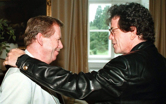 Czech President Vaclav Havel,left, gets a friendly pat on his shoulder from American rock star Lou Reed