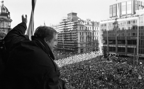Havel waves to people crowding Wenceslas Square in Prague on Human Rights Day