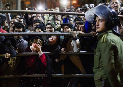 Iranians gather for a public execution in Tehran / AP