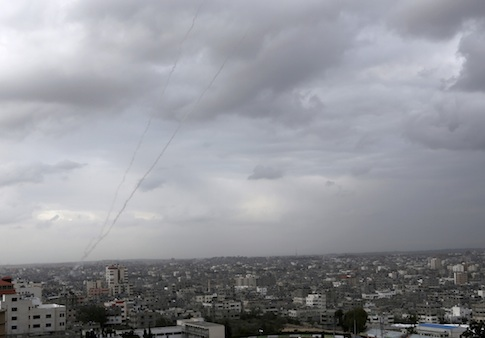 A trail of smoke from rockets fired by Palestinian militants from Gaza toward Israel is seen above Gaza City on Wednesday