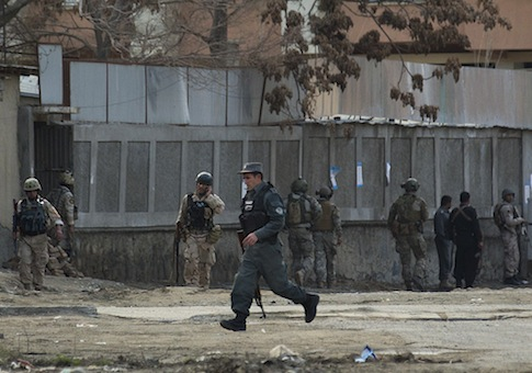 Afghan police and special forces respond to  a suicide bombing in Kabul / AP