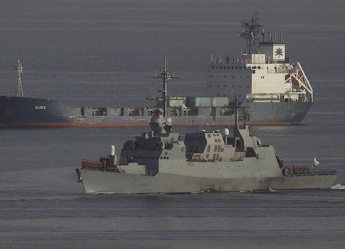 An Israeli naval warship escorts the seized Klos-C cargo ship  / AP