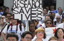 Demonstrators protest sequestration cuts to NIH funding / AP