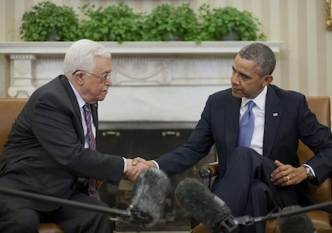 President Barack Obama shakes hands with Palestinian President Mahmoud Abbas at the White House / AP