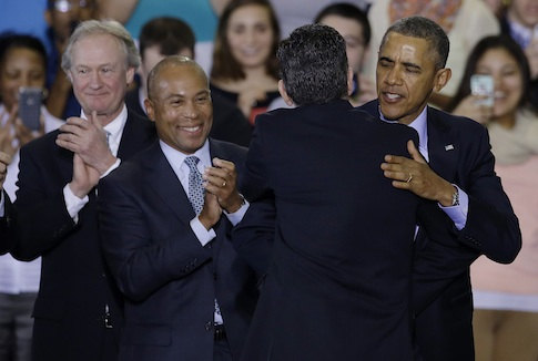President Barack Obama hugs Connecticut Gov. Dannel P. Malloy / AP