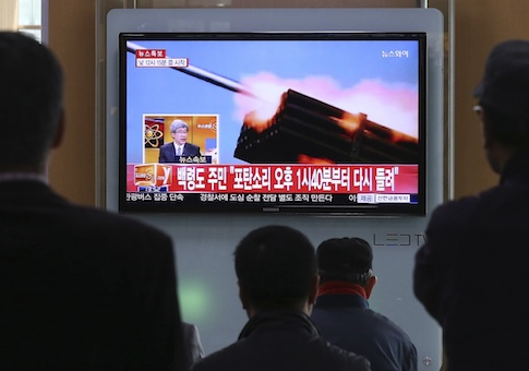 Passengers watch a television program showing reports on North Korea's plan to conduct live-fire drills, at a railway station in Seoul