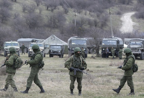 Russian soldiers guarding a Ukrainian infantry base / AP