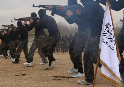 Members of Ahrar al-Sham brigade, one of the Syrian rebels groups, exercise in a training camp / AP