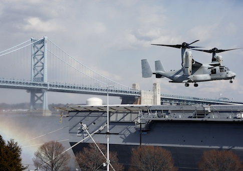 A Marines Osprey lands aboard the USS Somerset in view of the Benjamin Franklin Bridge