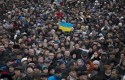 People gather in Kiev's Independence Square on Sunday / AP