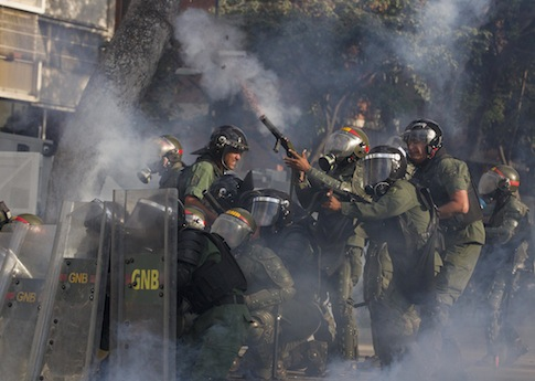 Bolivarian National Guard fire tear gas at demonstrators near Plaza Altamira in Caracas, Venezuela / AP