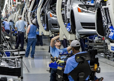 Workers assemble Volkswagen Passat sedans at the VW plant in Chattanooga, Tenn. / AP
