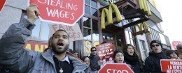 Demonstrators protest outside of a Boston McDonalds / AP