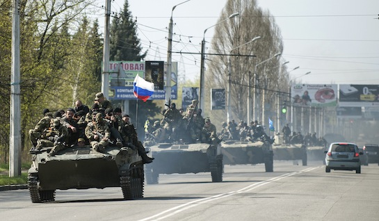A column of combat vehicles fly the Russian flag on the road to the eastern Ukrainian city Kramatorsk on April 16, 2014. (AP)