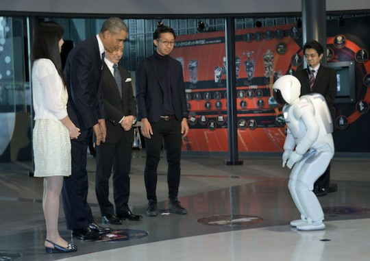 President Barack Obama bows to a Japanese robot. (AP)