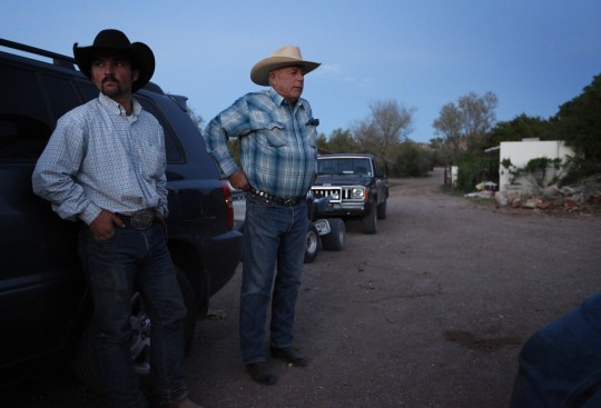 Cliven Bundy, right, and Clance Cox, left, stand at the Bundy ranch near Bunkerville Nev. Saturday, April 5, 2014. (AP)