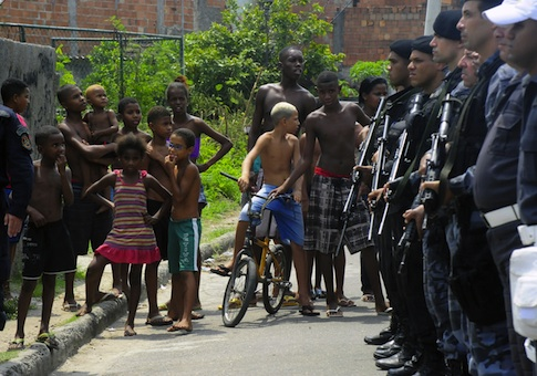 Children gather near police in Rio, Brazil / AP