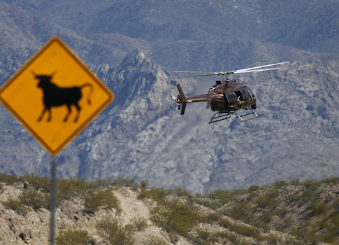 A helicopter takes off from a staging area of Bureau of Land Management outside the Bundy ranch / AP