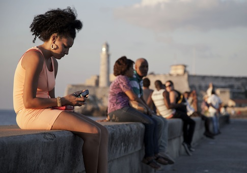 A woman uses her cellphone in Havana, Cuba / AP