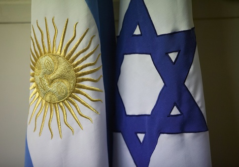 An Argentine and Israeli flag stand side by side