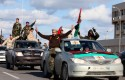 Libyan militias parade through Tripoli / AP