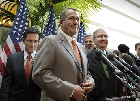 House Speaker John Boehner (R., Ohio) accompanied by fellow GOP leader Mitch McConnell (R., Ky.) / AP