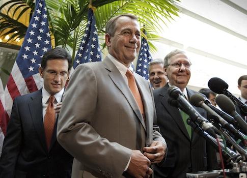 House Speaker John Boehner (R., Ohio) accompanied by fellow GOP leader Mitch McConnell (R., Ky.) / AP