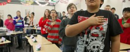Students recite the Pledge of Allegiance / AP