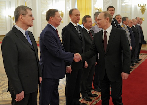 Russian President Vladimir Putin shakes hands with Kremlin's Chief of Staff Sergei Ivanov / AP