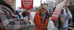 Protestors shred gun registration documents outside the Mahoney State building in Buffalo, NY / AP