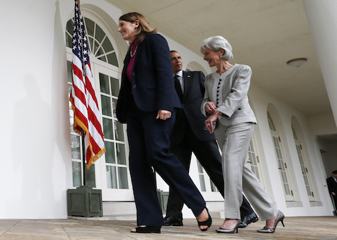 President Barack Obama walks with outgoing Health and Human Services Secretary Kathleen Sebelius / AP