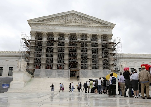 Visitors to the Supreme Court are pictured in the rain in Washington