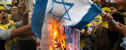 Iranian students burn the U.S and Israel flags in front of the former U.S. embassy in Tehran / AP