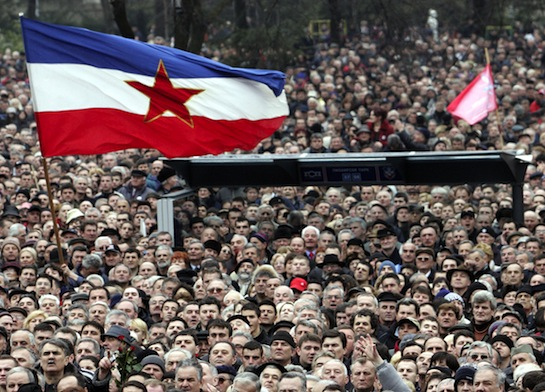 Supporters of Slobodan Milošević wave an old Yugoslav flag in Belgrade. (AP)
