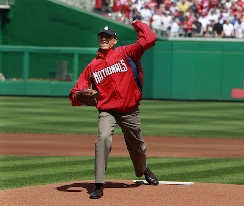 Obama struggles to throw a baseball in 2010 (AP)