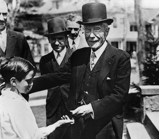 John D. Rockefeller hands out money to children.