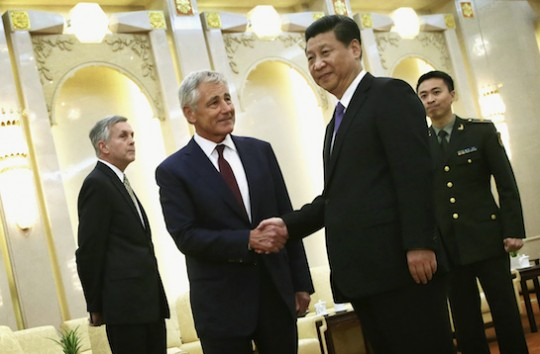 Chuck Hagel shakes hands with a communist. (AP)