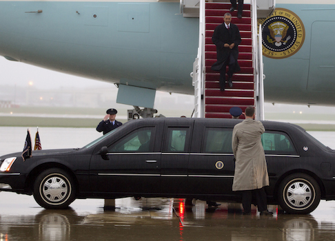 President Barack Obama walks down the stairs of Air Force One upon his arrival in the rain at Andrews Air Force Base / AP