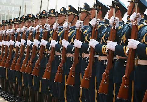Chinese honor guards stand to attention