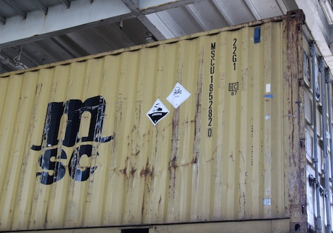 Signs are seen on one of the containers carrying precursors to sarin gas on the deck of the Ark Futura
