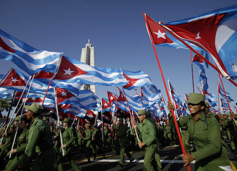 Cuban soldiers bearing their national flag / AP