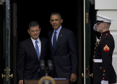 President Barack Obama walks to the podium with Secretary of Veterans Affairs Eric Shinseki / AP
