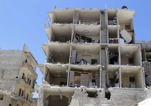A damaged building is pictured at a site in al-Katerji district in Aleppo