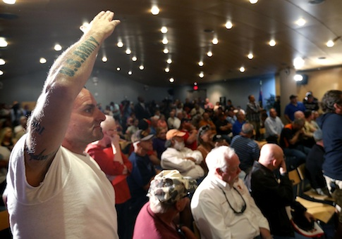 Veteran Mark Howey waits to ask a question as Sen. John McCain speaks during a forum with veterans regarding lapses in care