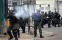 Bolivarian National Guards fire teargas at anti-government demonstrators  in Caracas, Venezuela / AP