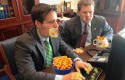 DCCC flack Marc Brumer stuffs his face with cheese doodles.