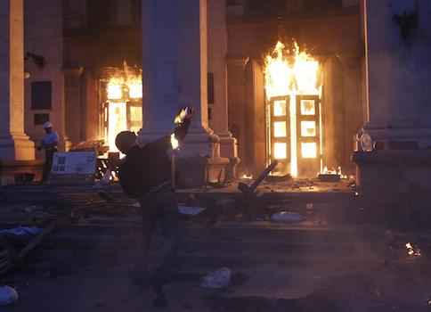 A protester throws a petrol bomb at the trade union building in Odessa May 2, 2014.  / AP