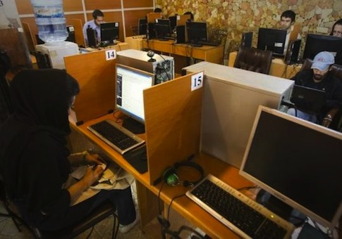 Customers use computers at an internet cafe in Tehran May 9, 2011.